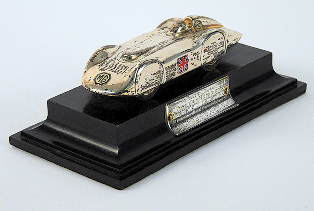 silver streamlined MG model car trophy