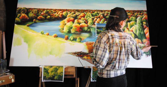 Artist Lily Hammond at work in her studio, Ashover