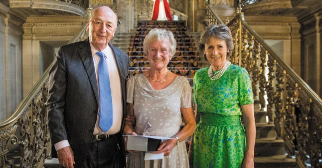 The Duke and Duchess of Devonshire with Pam Wildgoose at the League's 50th birthday party in The Painted Hall at Chatsworth.