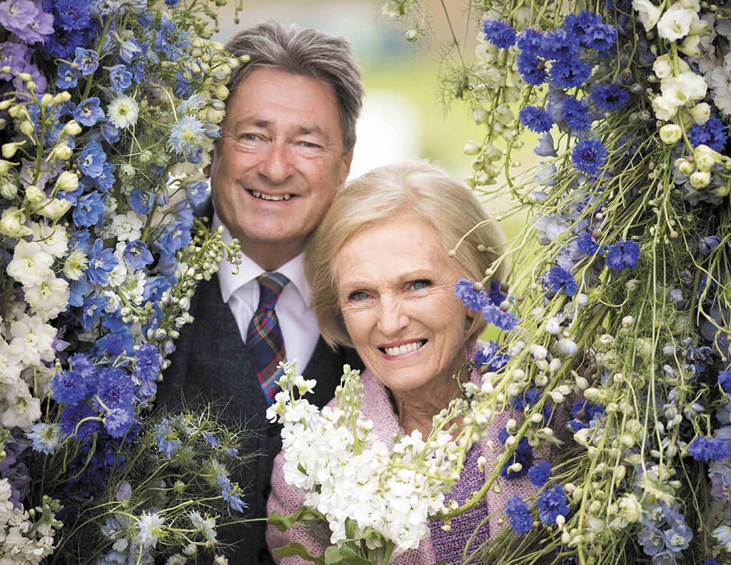 Smiling through the rain: TV presenters Mary Berry and Alan Titchmarsh launched the first RHS Chatsworth Flower Show.